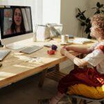 photo of child watching through imac